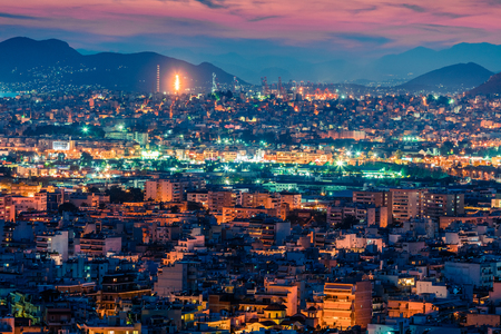 Colorful evening view of Athens, capital of Greece, Europe. Fantastic spring sunset in the big sity. Stockfoto