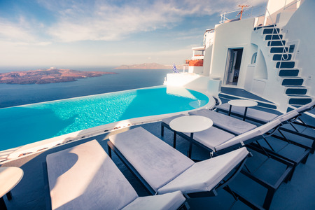 Bright morning view of Santorini island. Picturesque spring scene of the famous Greek resort Fira, Greece, Europe. Traveling concept background. Stock Photo