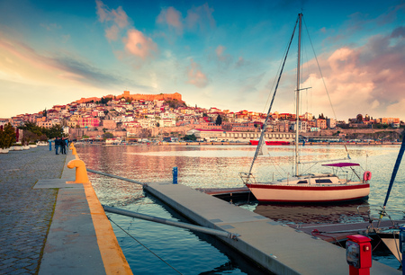 Sunny spring seascape on Aegean Sea. Coloful evening view of Kavala city, the principal seaport of eastern Macedonia and the capital of Kavala regional unit. Greece, Europe.