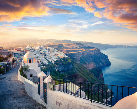 Dramatic morning view of Santorini island. Picturesque spring sunrise on the famous Greek resort Fira, Greece, Europe. Traveling concept background. Artistic style post processed photo. Stock Photo