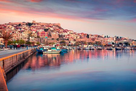 Sunny spring seascape on Aegean Sea. Coloful evening view of Kavala city, the principal seaport of eastern Macedonia and the capital of Kavala regional unit. Greece, Europe.