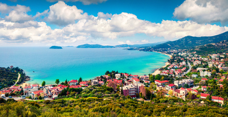Aerial view of Paleo Tsifliki village. Colorful spring morning on the Aegean Sea. Beautiful marine panorama of Greece. Beauty of countryside concept background. Artistic style post processed photo. Stock Photo