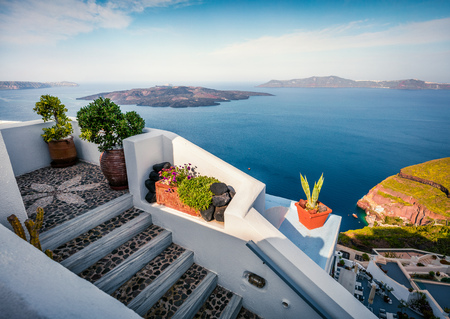 Sunny morning view of Santorini island. Picturesque spring scene of the  famous Greek resort Thira, Greece, Europe. Traveling concept background. Artistic style post processed photo.