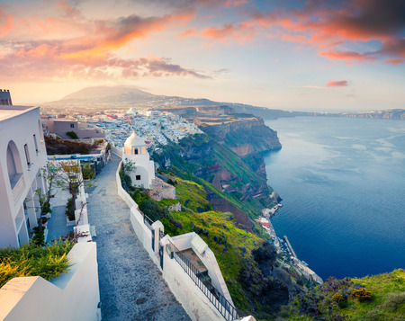Sunny morning view of Santorini island. Picturesque spring sunrise on the famous Greek resort Thira, Greece, Europe. Traveling concept background. Stock Photo