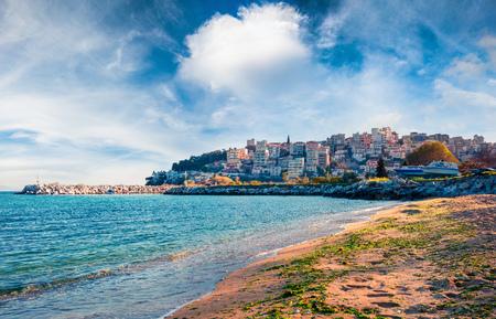 Sunny spring seascape on Aegean Sea. Coloful morning view of Kavala city, the principal seaport of eastern Macedonia and the capital of Kavala regional unit. Greece, Europe.