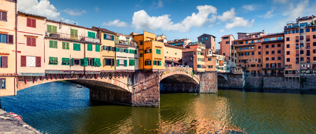 Picturesque medieval arched river bridge with Roman origins - Ponte Vecchio over Arno river. Colorful spring morning view of Florence, Italy, Europe. Traveling concept background.