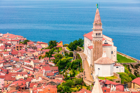 Aerial view of old town Piran. Colorful spring morning on Adriatic Sea. Beautiful cityscape of Slovenia, Europe. Traveling concept background. Magnificent Mediterranean landscape. Stock Photo