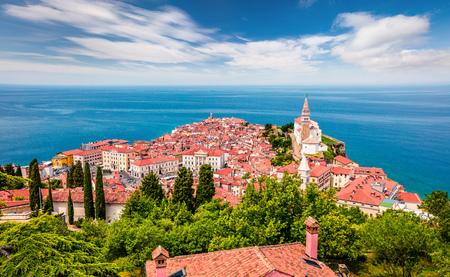 Aerial view of old town Piran. Splendid spring morning on Adriatic Sea. Beautiful cityscape of Slovenia, Europe. Traveling concept background. Magnificent Mediterranean landscape.