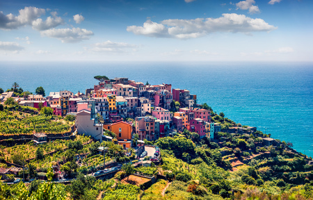 Third village of the Cique Terre sequence of hill cities - Corniglia. Colorful spring morning in Liguria, Italy, Europe. Picturesqie seascape of Mediterranean sea. Traveling concept background.