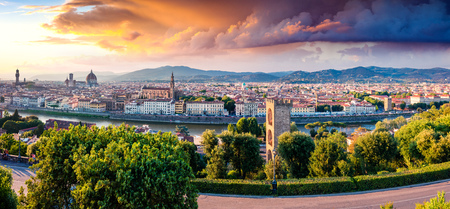 Unbelievable spring cityscape of Florence with Cathedral of Santa Maria del Fiore (Duomo) and Basilica of Santa Croce. Colorful sunset in Tuscany, Italy, Europe. Traveling concept background.