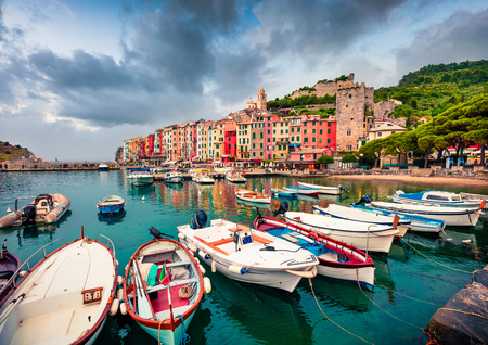 Cloudy morning view of Portovenere town. Picturesque spring seascape of Mediterranean sea,  Liguria, province of La Spezia, Italy, Europe. Traveling concept background. Stock Photo