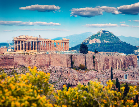 Great spring view of Parthenon, former temple, on the Athenian Acropolis, Greece, Europe. Colorful morning scene in Athens. Treveling concept background. Artistic style post processed photo.