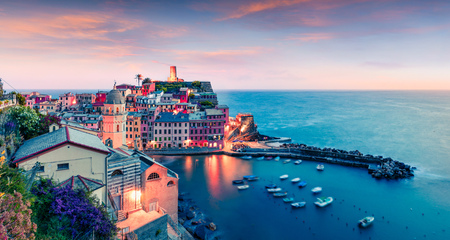 One of the five towns that make up the Cinque Terre region - Vernazza. Aerial spring sunrise in Liguria, Italy, Europe. Picturesqie seascape of Mediterranean sea. Traveling concept background.