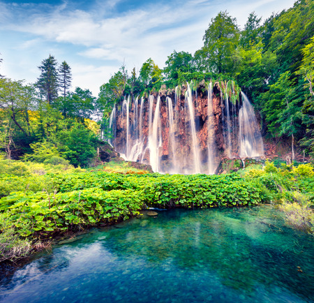 Splendid morning view of Plitvice National Park. Colorful spring scene of green forest with pure water waterfall. Great countryside landscape of Croatia, Europe. Beauty of nature concept background. Stock Photo