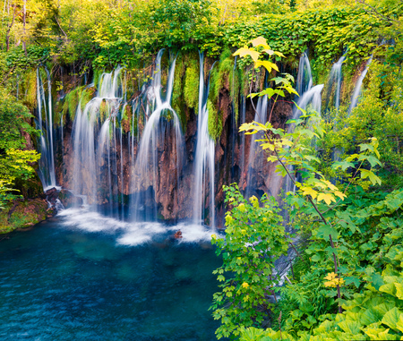 Colorful spring scene of green forest with pure water waterfall in Plitvice National Park. Great countryside landscape of Croatia, Europe. Beauty of nature concept background.