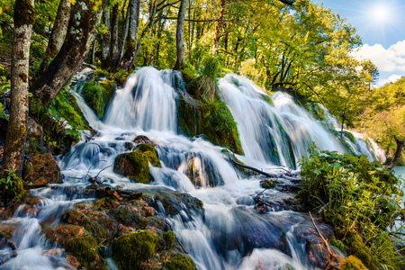 Splendid morning in Plitvice National Park. Colorful spring scene of green forest with pure water waterfall. Great countryside view of Croatia, Europe. Traveling concept background. Stock Photo