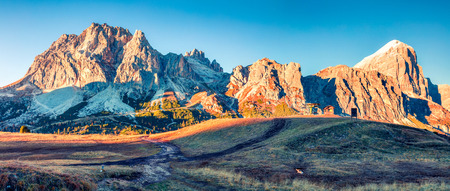 Panorama from top of Falzarego pass with Lagazuoi mountain. Colorful autumn morning in Dolomite Alps, Cortina dAmpezzo lacattion, Italy, Europe. Beauty of nature concept background.