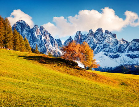 Fantastic view of Santa Maddalena village hills in front of the Geisler or Odle Dolomites Group. Colorful autumn scene of Dolomite Alps, Italy, Europe. Beauty of nature concept background. Stock Photo