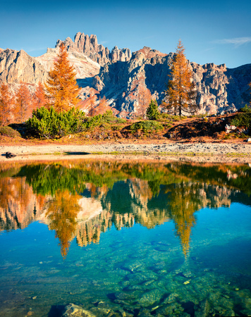 Splendid autumn view of Limides Lake. Colorful morning view of Dolomite Alps, Falzarego pass, Cortina d'Ampezzo lacattion, Italy, Europe. Beauty of nature concept background.