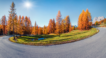 Empty asphalt road in Dolomite mountains. Colorful autumn scene in the Alps, Cortina dAmpezzo lacattion, Italy, Europe. Traveling concept background.