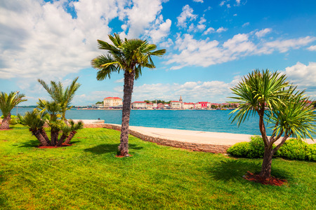 Sunny spring view of popular summer resort Porec. Colorful spring seascape of Adriatic Sea. Great morning scene of Istrian Peninsula in western Croatia, Europe. Vacation concept background. 写真素材