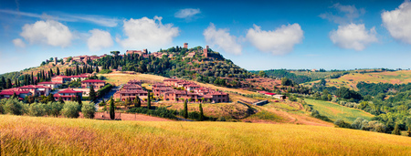Colorful spring view of Pienza town. Picturesque morning panorama of Tuscany, San Quirico dOrcia, Italy, Europe. Beauty of countryside concept background.
