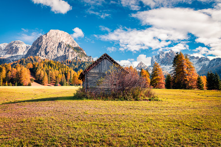 Sunny view of Rocca dei Baranci mountain from Vallone village. Colorful autumn scene in the Dolomite Alps, Province of Bolzano - South Tyrol, Itale, Europe. Artistic style post processed photo. Stock Photo