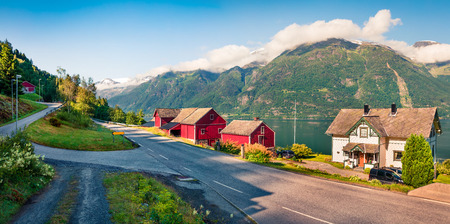 Sunny summer panorama of the Lofthus village in Ullensvang municipality which is located in the Hardanger region of Hordaland county, Norway. Beauty of countryside concept background.