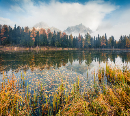 Foggy outdoor scene of Antorno lake. Colorful autumn morning in Dolomite Alps, National Park Tre Cime di Lavaredo, Italy, Europe. Beauty of nature concept background. Stock fotó