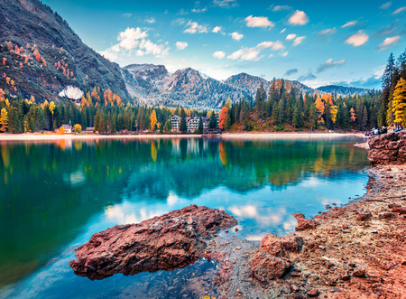 Beautiful morning on Braies Lake. Colorful autumn landscape of Italian Alps, Naturpark Fanes-Sennes-Prags, Dolomite, Italy, Europe. Traveling concept background. Stock Photo