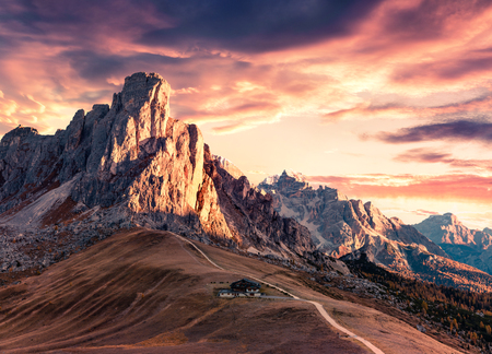 Breathtaking morning view from the top of Giau pass with famous Ra Gusela, Nuvolau peaks in background. Colorful autumn scene of Dolomite Alps, Cortina dAmpezzo location, Italy, Europe.