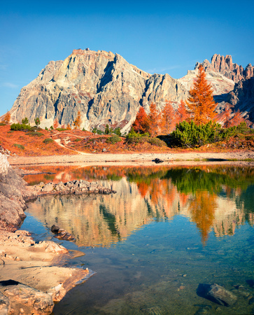 Splendid view of Limides Lake and Lagazuoi mountain. Colorful autumn morning in Dolomite Alps, Falzarego pass, Cortina d'Ampezzo lacattion, Italy, Europe. Beauty of nature concept background.