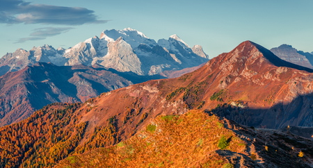 Amazing morning panorama from the top of Giau pass. Colorful autumn sunrise of Dolomite Alps, Cortina dAmpezzo location, Italy, Europe. Beauty of nature concept background.