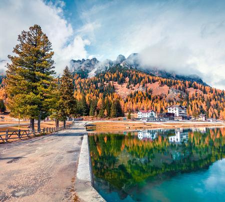 Sunny morning scene of Misurina lake in National Park Tre Cime di Lavaredo. Great autumn scene of Dolomite Alps, South Tyrol, Location Auronzo, Italy, Europe. Traveling concept background. Stock Photo