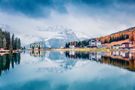 Misty morning scene of Misurina lake in National Park Tre Cime di Lavaredo. Fantastic autumn landscape in Dolomite Alps, South Tyrol, Location Auronzo, Italy, Europe. Traveling concept background.