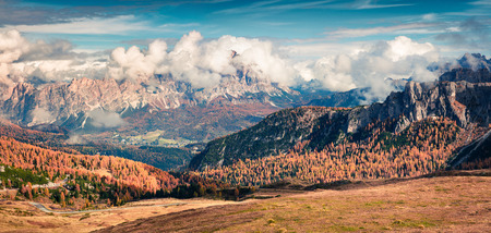 Splendid morning panorama from the top of Giau pass. Colorful autumn view ofn Dolomite Alps, Cortina dAmpezzo location, Italy, Europe. Beauty of nature concept background.