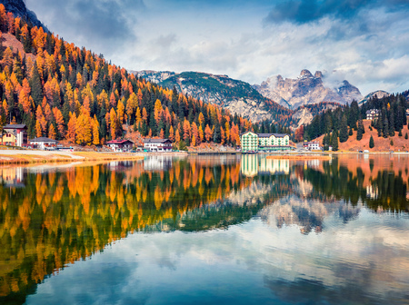 Impressive morning scene of Misurina lake in National Park Tre Cime di Lavaredo. Colorful autumn view of Dolomite Alps, South Tyrol, Location Auronzo, Italy, Europe. Beauty of countryside concept background. Фото со стока