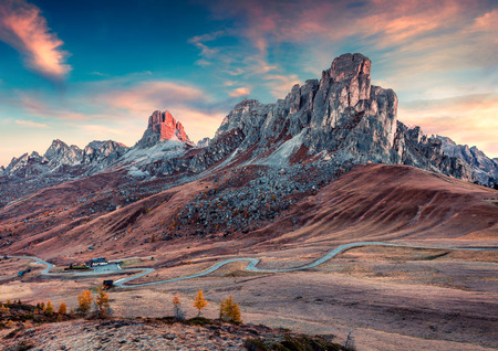 Fantastic morning view from the top of Giau pass with Ra Gusela and Nuvolau peaks on background. Colorful autumn scene of Dolomite Alps, Cortina dAmpezzo location, Italy, Europe. Stock Photo