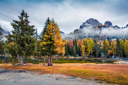 Foggy outdoor scene of Antorno lake. Colorful autumn morning in Dolomite Alps, National Park Tre Cime di Lavaredo, Italy, Europe. Beauty of nature concept background. Stock Photo