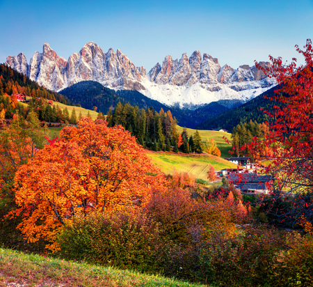 Impressive view of Santa Maddalena village hills in front of the Geisler or Odle Dolomites Group. Colorful autumn scene of Dolomite Alps, Italy, Europe. Beauty of countryside concept background