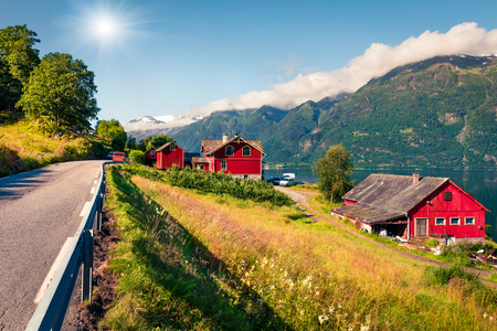 Sunny summer morning in Lofthus village in Ullensvang municipality which is located in the Hardanger region of Hordaland county, Norway. Beauty of countryside concept background.