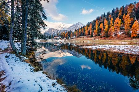 Splendid sunny scene of Antorno lake, Tre Cime di Lavaredo National park. Colorful autumn landscape of Dolomite Alps, Province of Belluno, Italy, Europe. Beauty of nature concept background.
