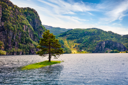 Splendid summer view of Suldalsvatnet lake. Picturesque morning scene in Norway, Europe. Beauty of nature concept background. Artistic style post processed photo.