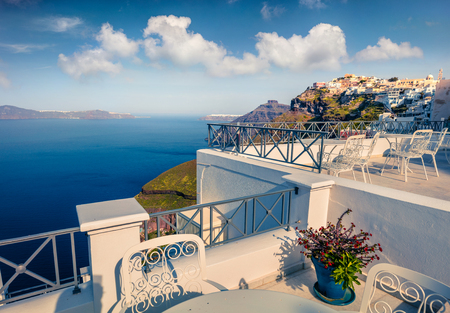 Sunny morning view of Santorini island. Picturesque spring scene of the famous Greek resort Thira, Greece, Europe. Traveling concept background.