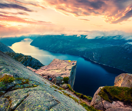 Impressive morning view of popular Norwegian attraction Preikestolen. Great summer sunrise of the Lysefjorden fjord, located in the Ryfylke area in southwestern Norway.