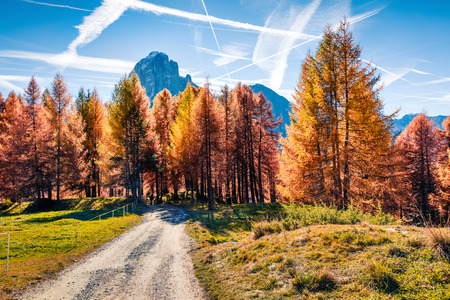Splendid autumn view of Ambrizola mountain. Colorful morning scene of Dolomite Alps, Cortina dAmpezzo lacattion, Italy, Europe. Beauty of countryside concept background. Stock Photo