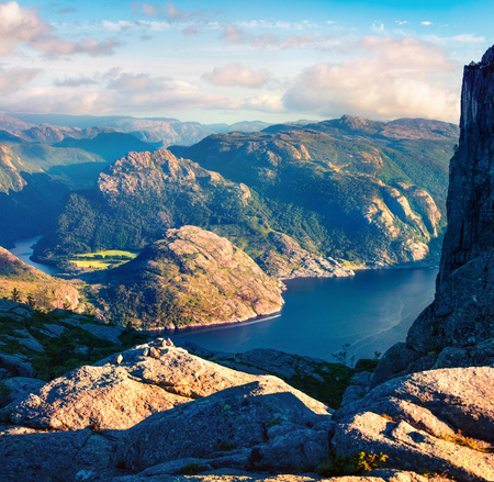 Colorful evening view of popular Norwegian attraction Preikestolen. Great summer scene of the Lysefjorden fjord, located in the Ryfylke area in southwestern Norway. Beauty of nature concept background.