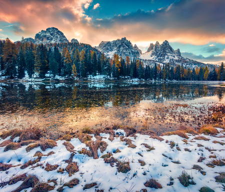 Great sunrise on Antorno lake. Picturesque autumn morning in Dolomite Alps, Province of Belluno, Italy, Europe. Beauty of nature concept background. Stock Photo