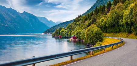 Colorful summer scene of Hjorundfjorden fjord, Orsta municipality, More og Romsdal county. Colorful morning panorama of Norway. Traveling concept background.