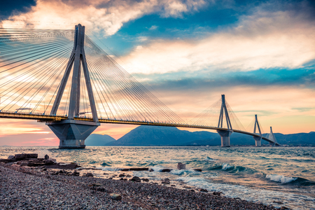Dramatic evening scene with Rion-Antirion Bridge. Colorful spring scene of the Gulf of Corinth, Greece, Europe. Beauty of countryside concept background. Artistic style post processed photo. 免版税图像 - 116546703
